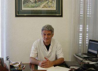Dr Eric Simoni